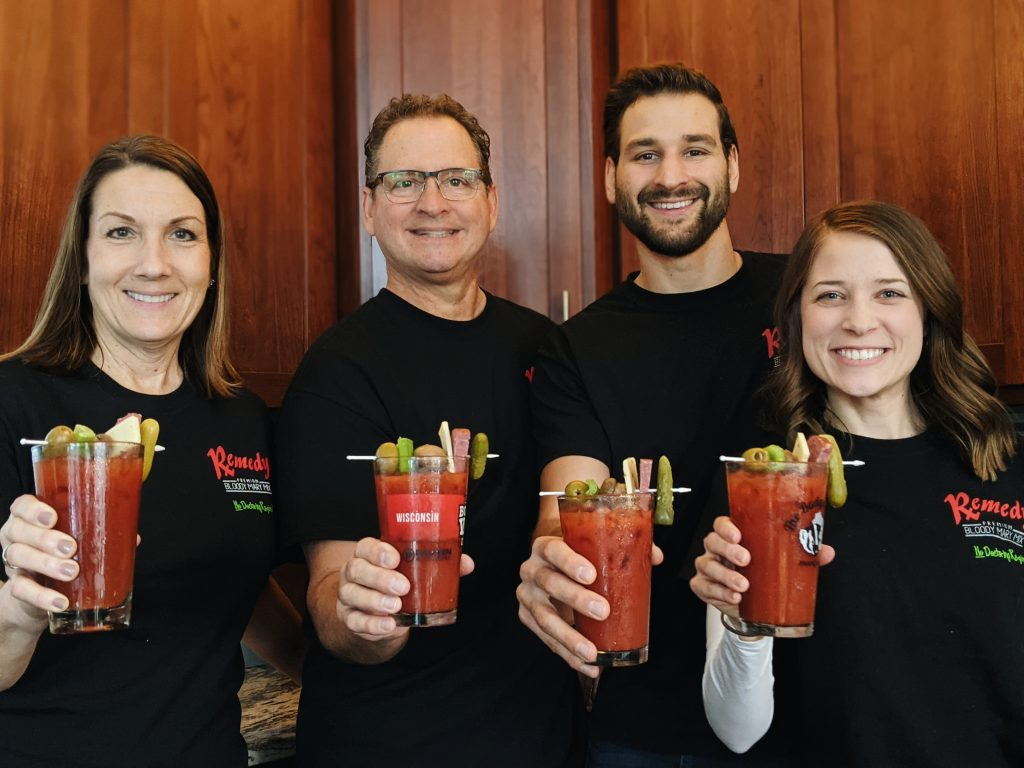 Remedy team photo holding bloody marys